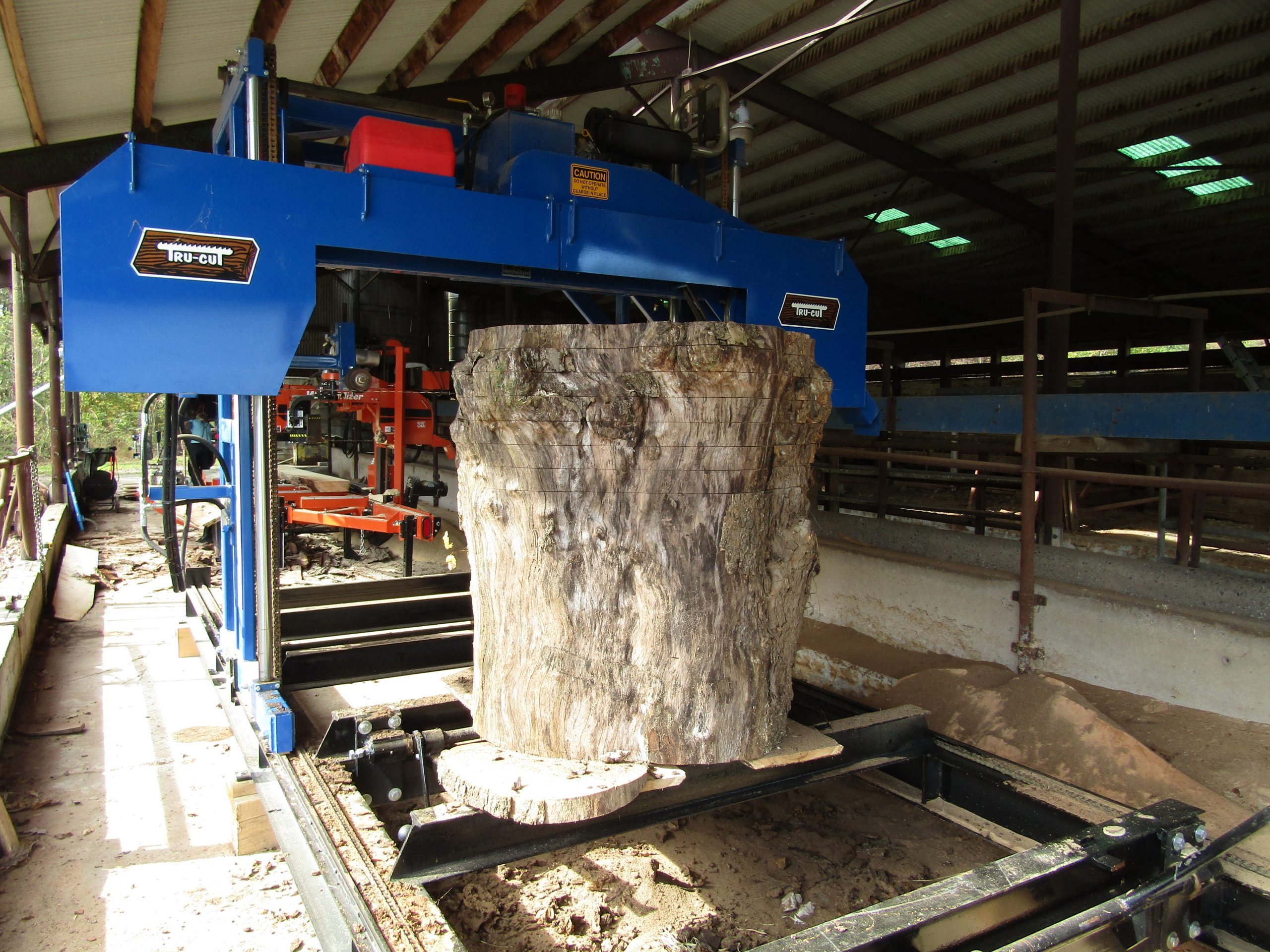 large piece of wood going through mill